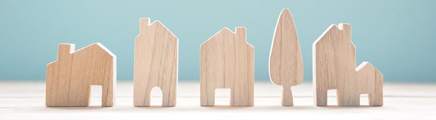 casas de madera que representan la calidad de datos